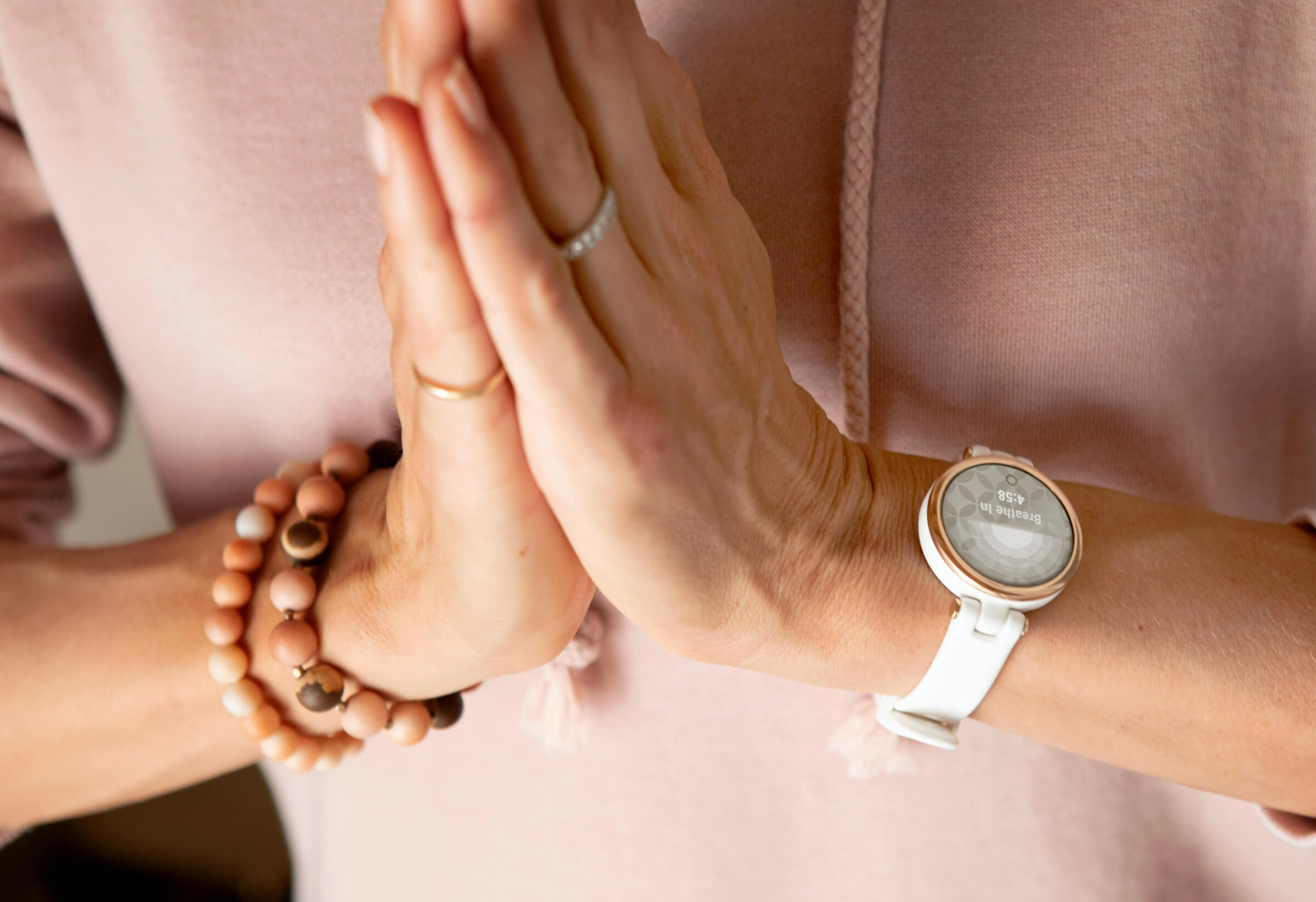 Picture of woman wearing Lily smartwatch or women by Garmin.