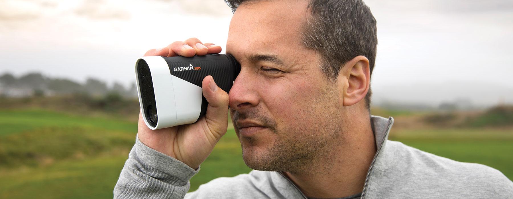 Golf Science - A man using the Garmin Laser Range Finder